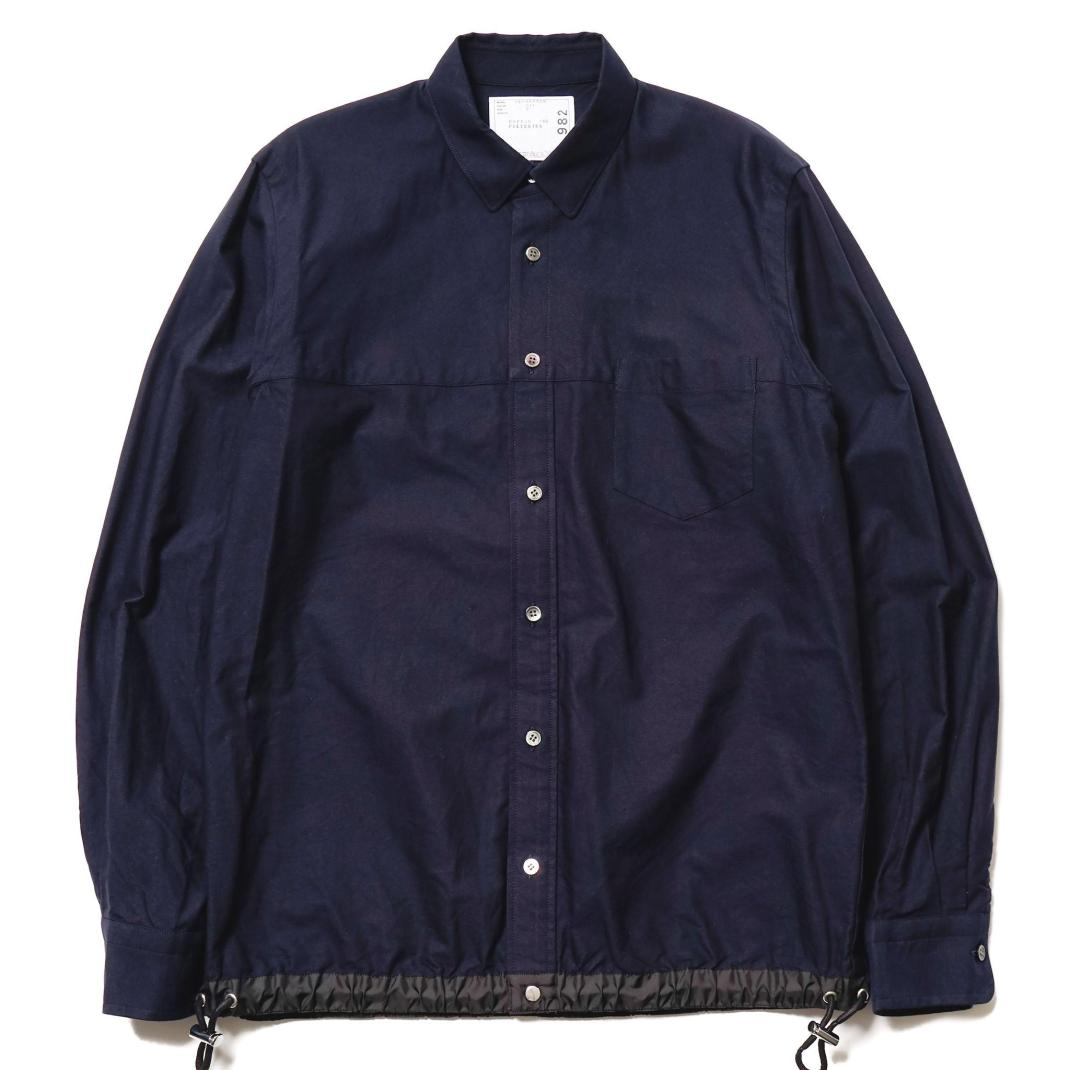 Sacai-Oxford-Drawcord-Shirt-Navy-1_2048x2048